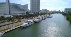 Aerial tour mega yachts in Miami Beach 44th Street Stock Footage