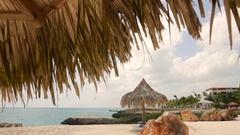 Pavilions on the beach, sand sun sea Stock Footage