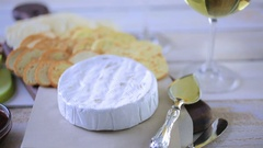 Brie cheese and cracker appetizer for  party table. Stock Footage