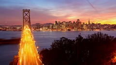 Timelapse of the Bay Bridge traffic, San Francisco skyline sunset Arkistovideo