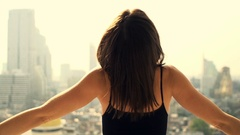 Woman stretching arms and admire view from window at home, super slow motion  Stock Footage