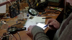 White man repairing a broken electronic led lamp in old workshop Stock Footage