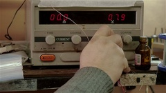 Hand white men switches on measuring instrument in workshop Stock Footage
