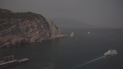 Big rock in the sea. Sea. A ship at sea. Summer. Stock Footage