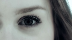Beautiful woman in close up up, with highlights in her eye Stock Footage