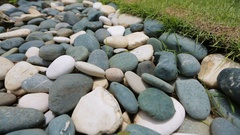 Oval stones on the ground Stock Footage