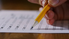 4K Close up of pencil being used on a multiple choice test paper Stock Footage