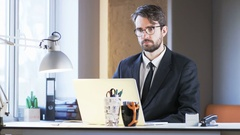 Young Businessman Having a Break at Work Stock Footage