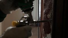 Man using polyurethane foam for installing new door Stock Footage