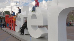 View of I Amsterdam sign and people on Amsterdam's Museumplein, Netherlands Stock Footage