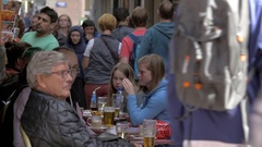 View of a lot of people on the pedestrian shopping street Nieuwendijk, Amsterdam Stock Footage