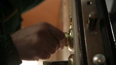 Installing new door lock Stock Footage
