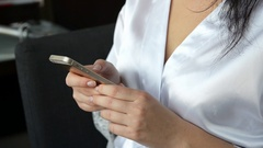 Bride typing sms by the mobile phone Stock Footage