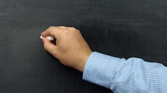 Famous Albert Einstein s equation E=mc2 handwritten on chalkboard or blackboard Stock Footage