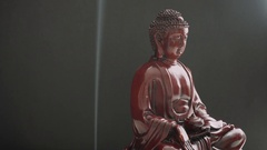 Buddha statue with incense. Symbols of Buddhism. Spiritual life of Asia Stock Footage