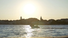 Pleasure boats moving by Venice landmarks at dusk, sightseeing trip for tourists Stock Footage