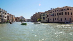 Old architecture of Venice streets seen from canal, sunlight sparkling on water Stock Footage