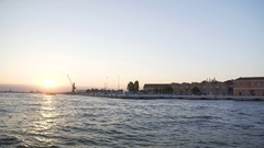 Many houses on bank of Grand Canal in Venice, sun going down, view from water Stock Footage
