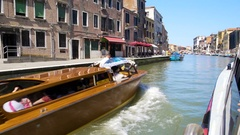 Tourists travelling by water taxi along Venice canal, transportation services Stock Footage