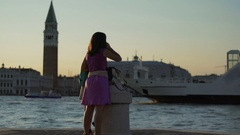 Two female tourists enjoying view of Venice cityscape, Campanile bell tower Stock Footage
