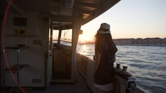 Lonely female tourist standing on board of vessel, viewing Venice from water Stock Footage