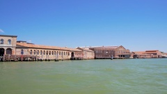 Murano island buildings seen from canal, tourist trip to Venice, sightseeing Stock Footage