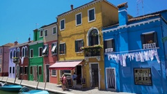 Men and women entering nice cafe on colorful Burano island, travel to Venice Stock Footage