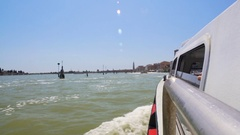 Vaporetto vessel moving along Grand Canal, tourists on sightseeing trip, Venice Stock Footage