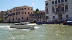 Tourists enjoying leisure trip around Venice on board of vaporetto water taxi Stock Footage