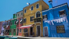 Travellers enjoying leisure trip, taking photo in colorful Burano island street Stock Footage