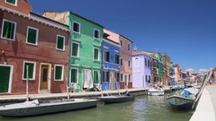 Sunny day on Burano island, nice coloured houses along canal, summer tourism Stock Footage