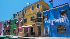Crowd of tourists viewing colorful architecture of Burano island from bridge Stock Footage