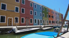 Panorama of multicolored buildings in street on Burano island in Venice Lagoon Stock Footage