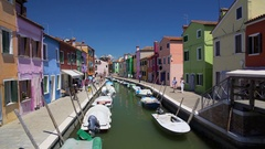 Many tourists viewing brightly colored houses in Burano island street, Venice Stock Footage