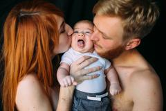 Happy family on a black background Stock Photos