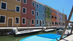 Deserted street of Burano island, colorful houses with closed windows, Venice Stock Footage