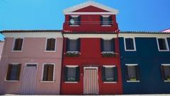 Amazing sunlit colorful houses, beautiful creative architecture on Burano island Stock Footage
