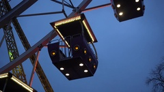 Ferris wheel in an amusement Park. Working Ferris wheel with neon lights. Stock Footage