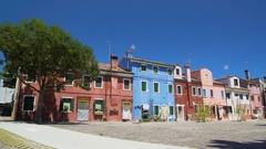 Beautiful deep blue sky above shabby colored houses, Burano island, Venice Stock Footage