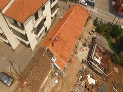 Aerial footage made by professional drone of men working on rebuilding old house Stock Footage