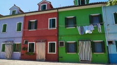 Nice well-kept colorful residence houses, vivid architecture of Burano island Stock Footage