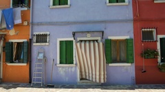 Nice house painted in blue color, famous vivid architecture on Burano island Stock Footage