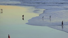 Timelapse of Beach goers on San francisco's Ocean Beach at Sunset Stock Footage