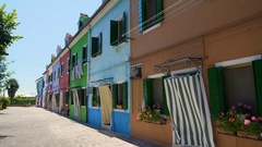 Beautiful street with brightly colored houses, famous Burano island architecture Stock Footage