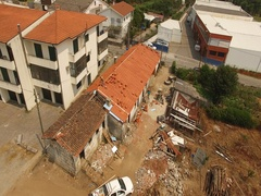 Top View made Professional Drone of Man Puting a New Roof in Old House Stock Footage