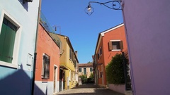 Nice colorful street on Burano island, bright color composition in architecture Stock Footage