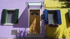 Bright lilac and yellow houses with sweet flowers on windows, cozy neighborhood Stock Footage