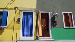 Beautiful yellow and grey houses, good neighborhood and togetherness traditions Stock Footage