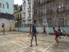 Young naughty latino cubano children play football on square in the center city Stock Footage