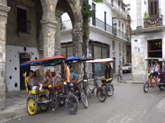 Trishaws without passengers are parked on touristic street near square in Havana Stock Footage